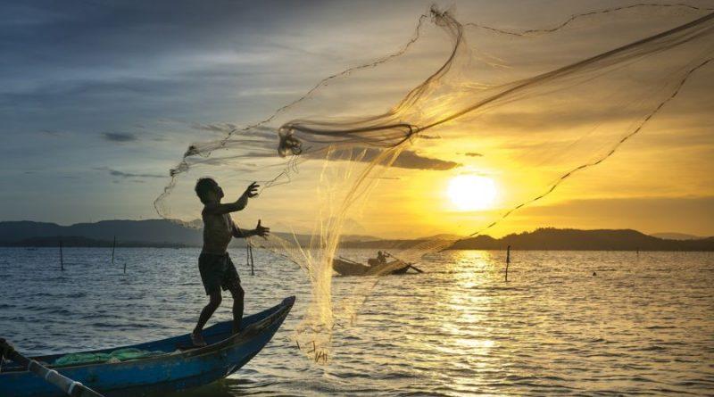 Vietnam sunset fishermen