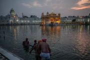 India Amritsar Golden temple pilgrims at the evening